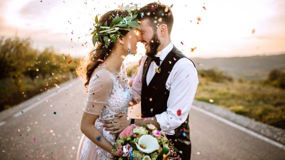 Wedding couple in love, confetti